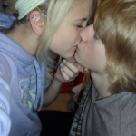 Blonde teen kissing her boyfriend