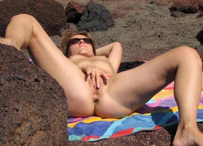 Horny amateur wife masturbating on the beach